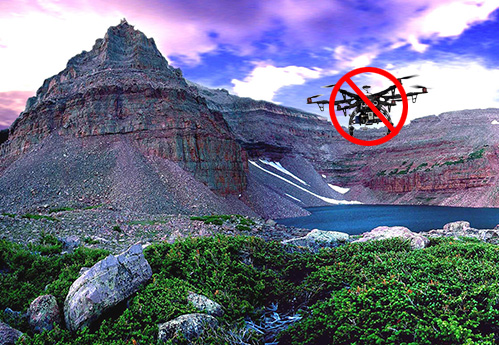 Drone flying over a scenic landscape.