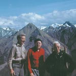 Olaus Murie, Howard Zahniser and Adolph Murie stand in front of an Alaskan mountain range. More about this picture plus a quote in the inset below.