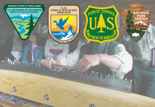 Man sharpening a crosscut saw with agency logos--Bureau of Land Management, Fish and Wildlife Service, Forest Service, National Park Service--logos.